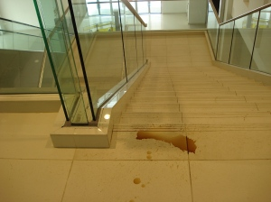 Coffee stains at the top landing of the stairs